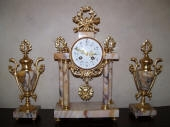 Gold Leaf Gilding to French Antique Clock & Ornaments